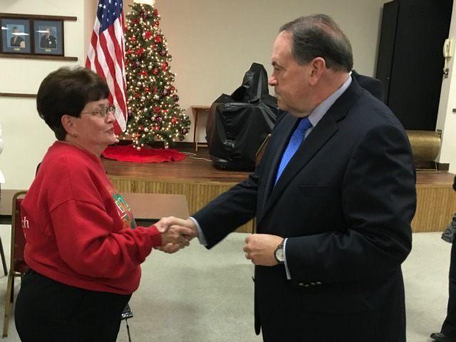 GOP presidential candidate former Arkansas Gov. Mike Huckabee meets voters in WOODBRIDGE, Virginia, Dec. 4, 2015.