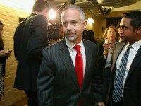 Rep. Tim Huelskamp (R-KS) (C) leaves a House Republican caucus meeting in the U.S. Capitol October 21, 2015 in Washington, DC. A member of the far-right House Freedom Caucus, Huelskamp said that House Ways and Means Committee Chairman Paul Ryan is asking for 'more power and less responsibility' in his pursuit of the speakership. (Photo by C