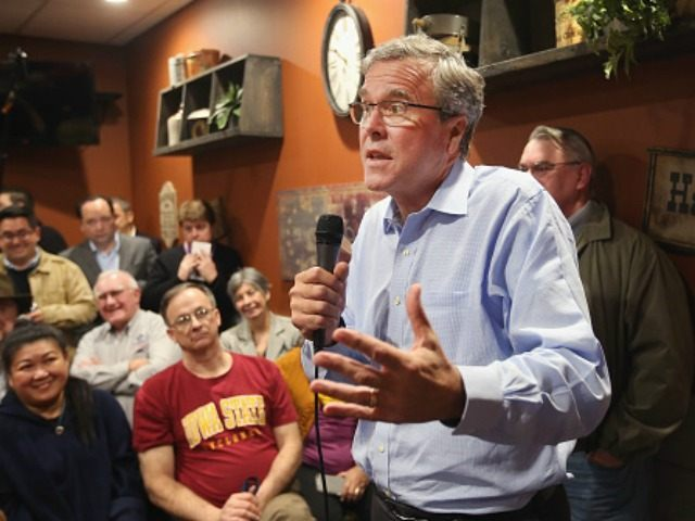 Former Florida Governor Jeb Bush speaks to Iowa residents at a Pizza Ranch restaurant on March 7, 2015 in Cedar Rapids, Iowa. Earlier in the day Bush spoke at the Iowa Ag summit in Des Moines. The Ag Summit allowed the invited speakers, many of whom are potential 2016 Republican …