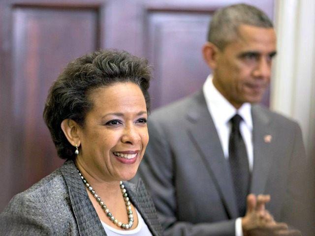 Lynch and Obama Carolyn Kaster AP