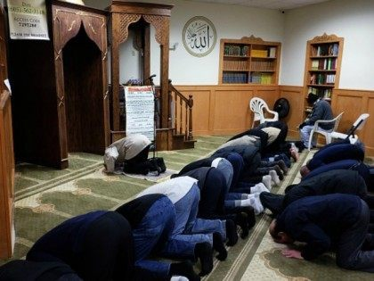 Muslim men pray at a mosque in Jersey City, New Jersey, on December 7, 2015. Muslim American leaders accused Republican Presidential hopeful Donald Trump of incitement for demanding a 'complete shutdown' of Muslims entering the US after a New York shopkeeper was beaten in an alleged hate crime. Trump's stunning …