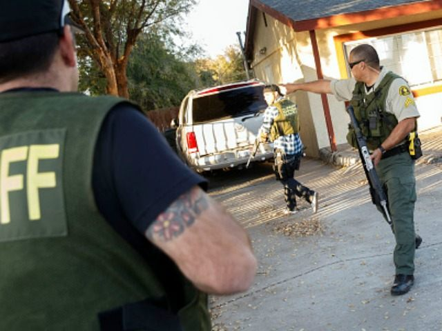 Law enforcement officers search for the suspects of a mass shooting December 2, 2015 in San Bernardino, California. A man and a woman suspected of carrying out a deadly shooting at a center for the disabled were killed in a shootout with police, while a third person was detained, police said. AFP PHOTO / PATRICK T. FALLON / AFP / Patrick T. Fallon (Photo credit should read