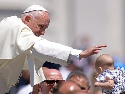 Pope Francis blesses a baby during his weekly general audience at St Peter's square on June 10, 2015 at the Vatican. AFP PHOTO / FILIPPO MONTEFORTE (Photo credit should read FILIPPO MONTEFORTE/AFP/Getty Images)