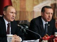 Russia's president Vladimir Putin gives a press conference with Turkish Prime minister Recep Tayyip Erdogan (R) in Istanbul on December 3, 2012, as part of Putin's trip focused on resolving sharp differences over the near 21-month conflict raging in Syria. AFP PHOTO/BULENT KILIC (Photo credit should read BULENT KILIC/AFP/Getty Images)