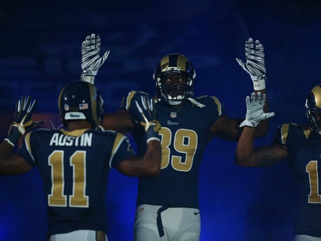 Tavon Austin #11, Jared Cook #89, Chris Givens #13 of the St. Louis Rams pay homage to Mike Brown by holding their hands up during their pre-game introduction against the Oakland Raiders at the Edward Jones Dome on November 30, 2014 in St. Louis, Missouri. The Rams beat the Raiders …