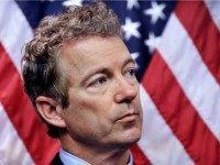 Rand Paul with U.S. flag backdrop