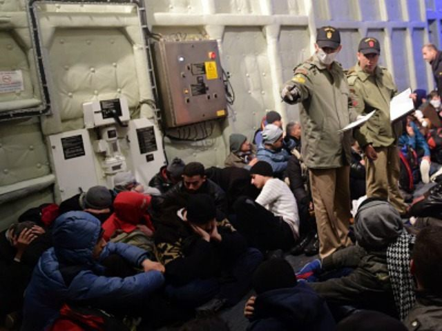 Syrian migrants wait aboard the Turkish Coast Guard ship Umut after being rescued while attempting to reach the Greek Island Chios on the Agean Sea near Izmir in the night of December 9 to December 10, 2015. More than 886,000 migrants have arrived in Europe by sea so far this …