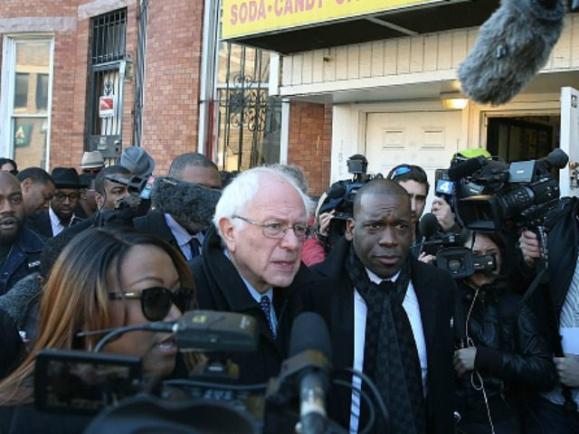 Democratic presidential candidate Sen. Bernie Sanders, (I-VT) is given a tour of Sandtown-Winchester Neighborhood where Freddie Gray lived and was arrested, December 8, 2015 in Baltimore, Maryland. Sen. Sanders later met with African-American religious and civic leaders. (Photo by