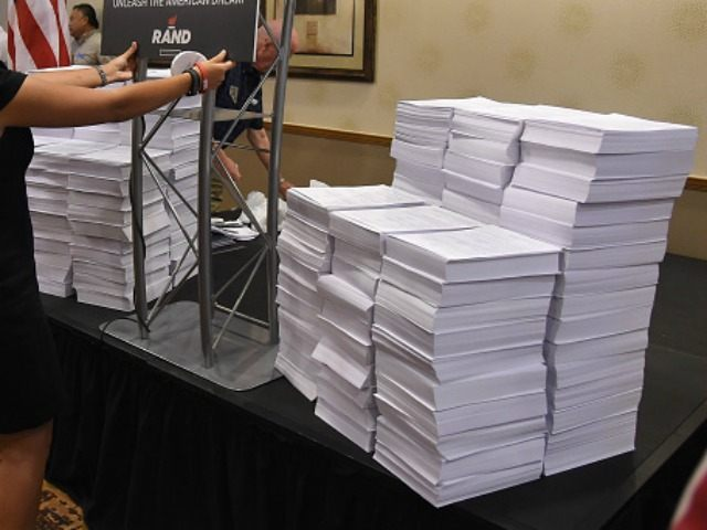 Republican presidential candidate U.S. Sen. Rand Paul (R-KY) speaks provides a copy of the u.s tax code during a campaign stop at an Embassy Suites hotel on June 29, 2015 in Las Vegas, Nevada.