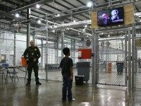 A boy from Honduras watches a movie at a detention facility run by the U.S. Border Patrol on September 8, 2014 in McAllen, Texas. The Border Patrol opened the holding center to temporarily house the children after tens of thousands of families and unaccompanied minors from Central America crossed the …