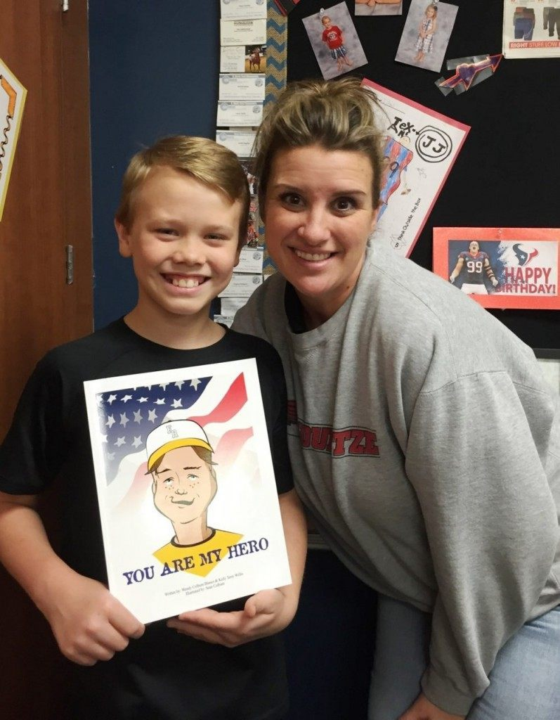 "Wendy Colburn-Blanco and a student with ""You Are My Hero."" (Photo Courtesy of Kelly Terry-Willis)"
