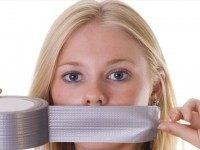 Woman-tapes-her-mouth-with-duct-tape-Shutterstock-800x430