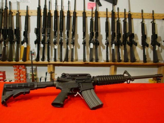 Colt AR-15, now legal with a bayonet mount, flash suppressor, collapsible stock and a high capacity magazine that holds more than 30 rounds, sits on the counter of Dave's Guns September 13, 2004 in Denver, Colorado.