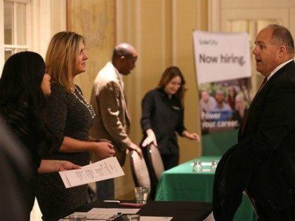 A job seeker (R) meets with recruiters during the HireLive Career Fair on November 12, 2015 in San Francisco, California. The national unemployment rate stands at 5 percent.