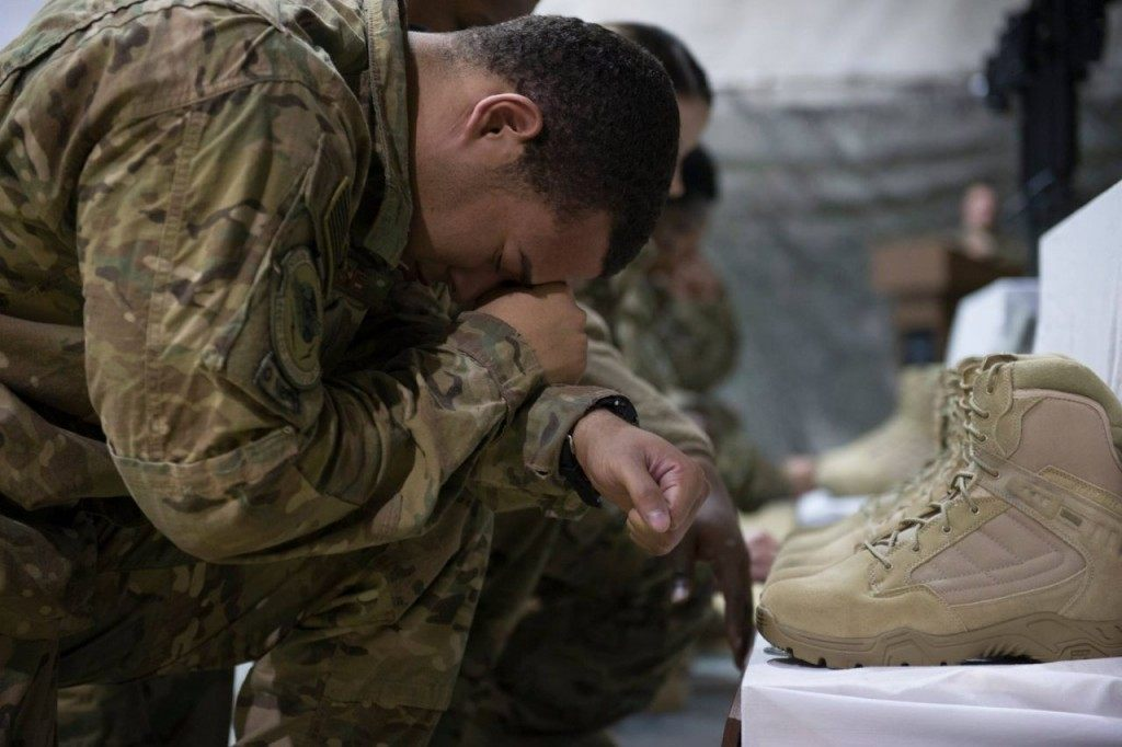 Service members from several units at Bagram Airfield, Afghanistan pay their respects during a fallen comrade ceremony held in honor of six Airmen Dec. 23, 2015. (U.S. Air Force photo by Tech. Sgt. Robert Cloys)