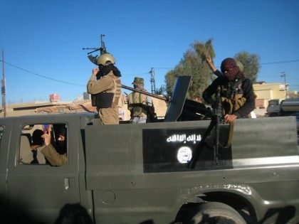 "FILE - in this Thursday, March 20, 2014 file photo, Islamic State group militants patrol in a commandeered Iraqi security forces trucks sprayed with the representation of the al-Qaida flag and the Arabic that reads, ""There is no god but Allah,"" in Fallujah, 40 miles (65 kilometers) west of Baghdad, …"