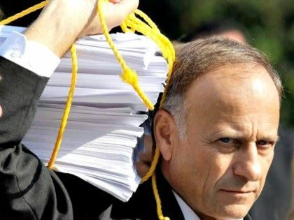 steve-king with sheaf of papers AP