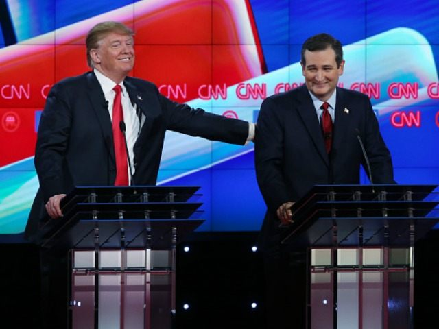 Republican presidential candidate Donald Trump (L) pats U.S. Sen. Ted Cruz (R-TX) after a comment during the CNN Republican presidential debate on December 15, 2015 in Las Vegas, Nevada. This is the last GOP debate of the year, with U.S. Sen. Ted Cruz (R-TX) gaining in the polls in Iowa and other early voting states and Donald Trump rising in national polls. (Photo by)