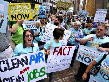 white people rally against climate change  AP photoGene J. Puskar