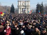 People attend the rally in front of the Parliament building in Chisinau on January 21, 2016.  Moldova braced for fresh protests on January 21 after the opposition called for more demonstrations against a new government that was secretly sworn in overnight.   / AFP / DORIN GOIAN        (Photo credit should read DORIN GOIAN/AFP/Getty Images)