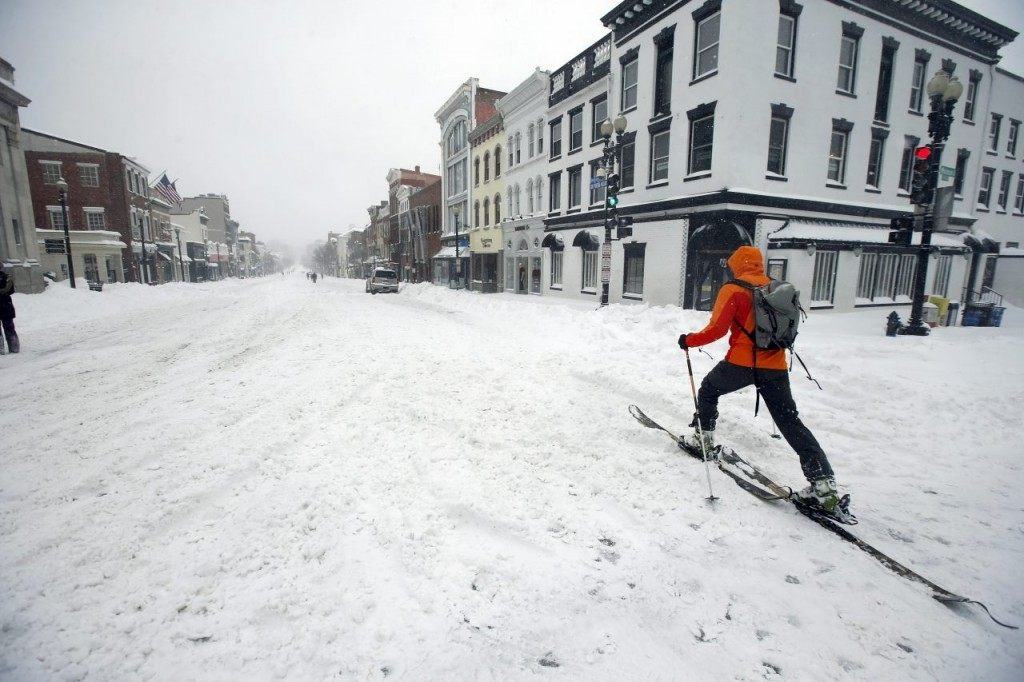 A man uses cross country skies as he goes down M Street NW in the snow, on Saturday in the Georgetown area of Washington. (AP Photo/Alex Brandon)
