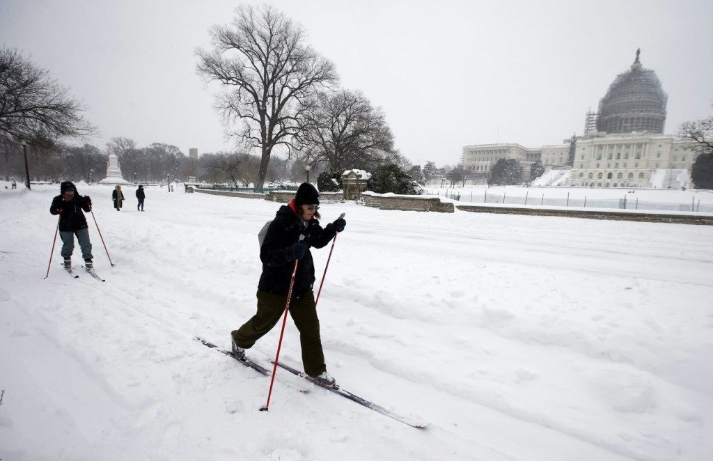 Two people use cross country skis to get around the snow in front of the U.S. Capitol on Saturday. (AP Photo/Alex Brandon)