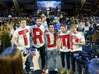 Liberty University students, Austin Miller, of Salisbury N.C., left, James Ford, of Elkton Md., second from left, Jeremy Boyd, of New York City, center, Josian O'Boyle, of Toronto Canada, second from right, and Cody Hildebrand, of Fayetteville W.Va., pose for photos with their home made t-shirts as they wait for a speech by Republican Presidential candidate Donald Trump at Liberty University in Lynchburg, Va., Monday, Jan. 18, 2016. (AP Photo/Steve Helber)