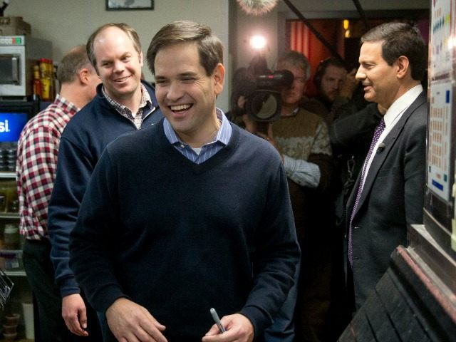 Republican presidential candidate Sen. Marco Rubio, R-Fla., departs through the kitchen after speaking at Wellman's Pub & Rooftop in West Des Moines, Iowa, Wednesday, Jan. 27, 2016. )