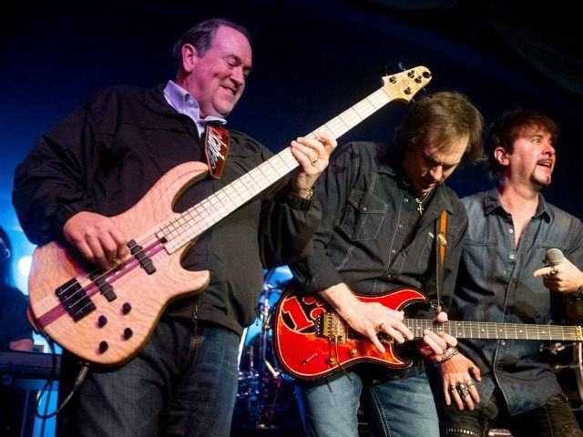 Republican presidential candidate former Arkansas Gov. Mike Huckabee, left, plays bass guitar as he performs with the 80's rock band FireHouse at the Surf Ballroom in Clear Lake, Iowa, Friday, Jan. 22, 2016. In 2008, Huckabee performed at the ballroom, made famous for being the last venue Buddy Holly played …