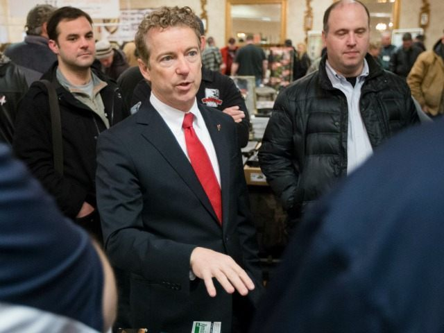 Republican presidential candidate, Sen. Rand Paul, R-Ky., center, meets with customers during a campaign stop at a gun show at Bektash Shrine Center, Saturday, Jan. 23, 2016, in Concord. (