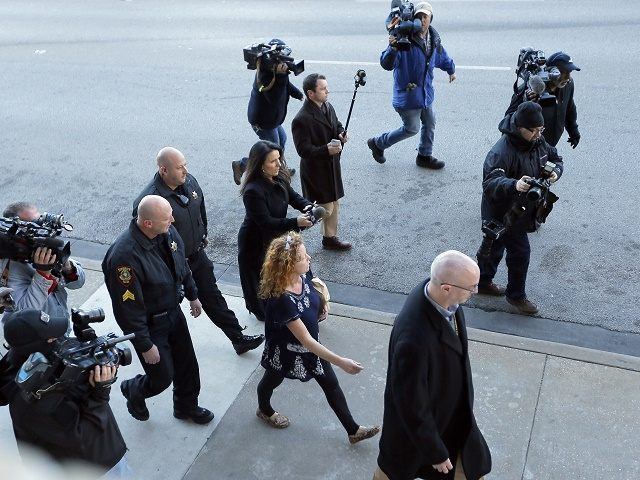 """Tonya Couch, bottom center, the mother of a Texas teen who used an """"affluenza"""" defense in a drunken wreck, leaves Tarrant County Jail, Tuesday, Jan. 12, 2016, in Fort Worth, Texas. She is to be fitted with a GPS monitor before release. A judge decreased Couch's bond Monday from $1 …"""