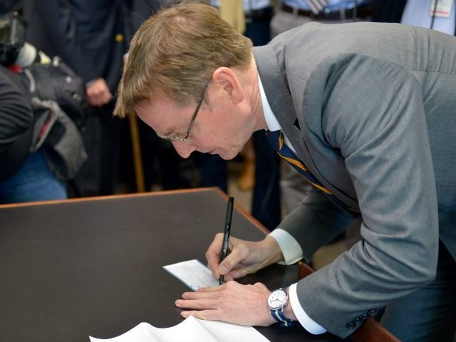 Lexington Ky. Mayor Jim Gray writes a check for the filing fee as he submits the paperwork to run for the U.S. Senate as a Democrat, Tuesday, Jan. 26, 2016, declaring his candidacy to unseat Sen. Rand Paul, R-Ky., on the day of Kentucky's filing deadline at the Kentucky State …