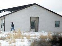 """A member of the group occupying the Malheur National Wildlife Refuge headquarters, walks to one of its buldings Monday, Jan. 4, 2016, near Burns, Ore. The group calls itself Citizens for Constitutional Freedom and has sent a """"demand for redress"""" to local, state and federal officials. Armed protesters took over …"""