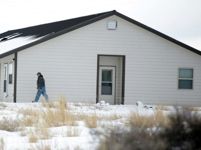"A member of the group occupying the Malheur National Wildlife Refuge headquarters, walks to one of its buldings Monday, Jan. 4, 2016, near Burns, Ore. The group calls itself Citizens for Constitutional Freedom and has sent a ""demand for redress"" to local, state and federal officials. Armed protesters took over …"