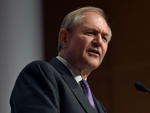 Republican presidential candidate, former Virginia Gov. Jim Gilmore waves as he arrives to speak at the Republican Jewish Coalition Presidential Forum in Washington, Thursday, Dec. 3, 2015.