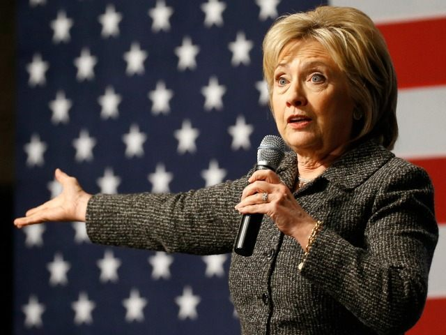 In this Jan. 12, 2016, photo, Democratic presidential candidate Hillary Clinton speaks during a campaign event at Iowa State University in Ames, Iowa. Challenged anew by Bernie Sanders, Clinton is reverting to some of the same themes, even strikingly similar attack lines, from her 2008 primary loss to Barack Obama.