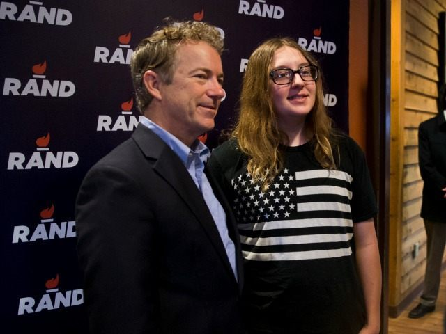Republican presidential candidate, Sen. Rand Paul, R-Ky. poses with supporter Dalton Reber during a campaign event at a restaurant, Friday, Jan. 8, 2016, in Ottumwa, Iowa.