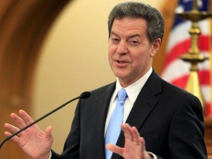 Kansas Gov. Sam Brownback delivers his State of the State address to a joint session of the legislature in Topeka, Kan., Tuesday, Jan. 12, 2016.