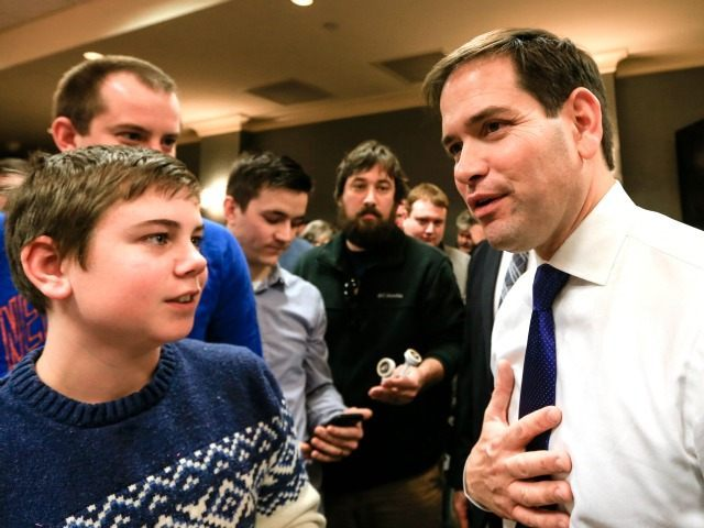 Republican presidential candidate, Sen. Marco Rubio, R-Fla., right, talks to members of the audience following a campaign stop in Council Bluffs, Iowa, Saturday, Jan. 16, 2016.