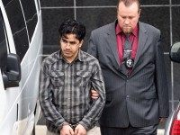 Omar Faraj Saeed Al Hardan, left, is escorted by U.S. Marshals from the Bob Casey Federal Courthouse on Friday, Jan. 8, 2016, in Houston. Al Hardan made his initial appearance in federal court in Houston Friday morning after he was indicted Wednesday on three charges related to accusations he tried …