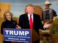 Republican presidential candidate Donald Trump, joined by John Wayne's daughter, Aissa Wayne, speaks during a news conference at the John Wayne Museum, Tuesday, Jan. 19, 2016, in Winterset, Iowa.