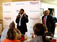 Republican presidential candidate Dr. Ben Carson, center, speaks during a town hall at Adams Street Espresso and Soda Shoppe in Creston, Iowa, Friday, Jan. 22, 2016.