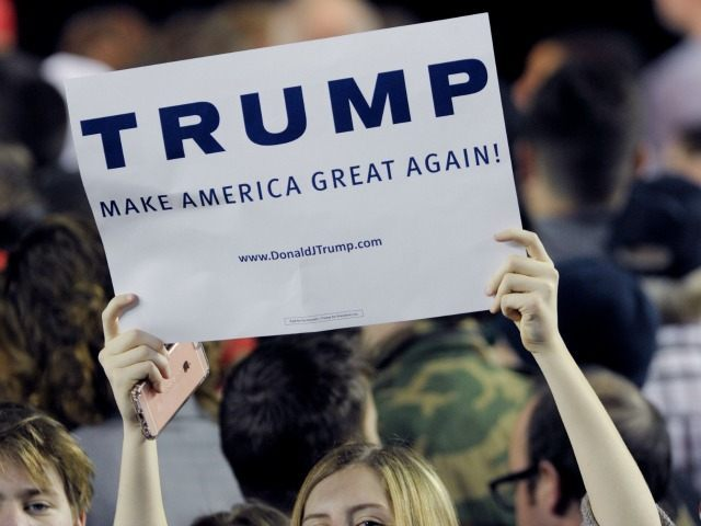 Donald Trump supporters hold up signs during a rally for Republican presidential candidate Donald Trump at the Mabee Center in Tulsa, Okla. Wednesday, Jan 20, 2016.(