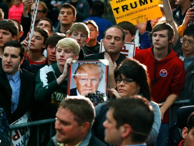 Audience members wait for Republican presidential candidate Donald Trump to pass during a campaign event at the University of Iowa Field House, Tuesday, Jan. 26, 2016 in Iowa City, Iowa.