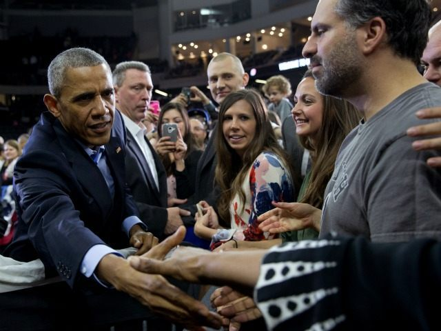 President Barack Obama greets people in the audience after speaking at University of Nebraska-Omaha, in Omaha, Neb., Wednesday, Jan. 13, 2016. After giving his State of the Union address, he is in Omaha, Neb., to tout progress and goals in his final year in office.