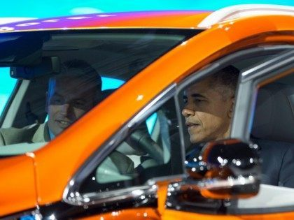 President Barack Obama sits in a new Chevrolet Bolt electric car with Patrick Foley, controls manager for the Bolt EV at GM in Detroit, as he visits the 2016 North American International Auto Show in Detroit, Wednesday, Jan. 20, 2016, to highlight the progress made by the American auto industry. …