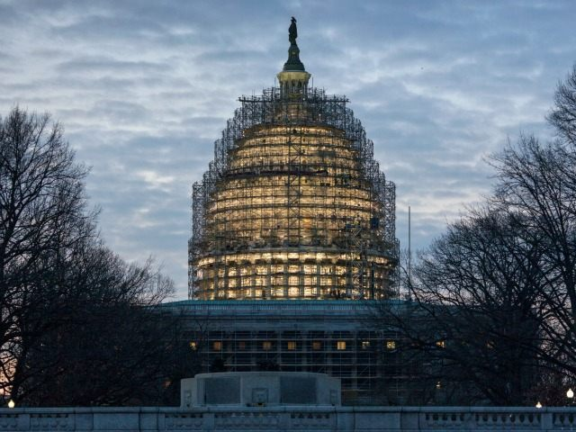 The Capitol Dome in Washington is illuminated early, Tuesday, Jan. 12, 2016.