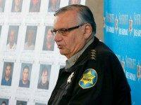 With mug shots of those arrested in the background, Maricopa County Sheriff Joe Arpaio announces dozens of arrests in a prostitution sting during a news conference at Maricopa County Sheriff's Office Headquarters Wednesday, Dec. 18, 2013, in Phoenix. Maricopa County sheriff's deputies made dozens of arrests in the sting in …