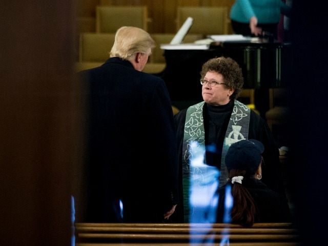 Republican presidential candidate Donald Trump speaks with Rev. Dr. Pamela Saturnia as he arrives for service at First Presbyterian Church in Muscatine, Iowa, Sunday, Jan. 24, 2016. Trump will be holding a rally at Muscatine High School in the afternoon. ()