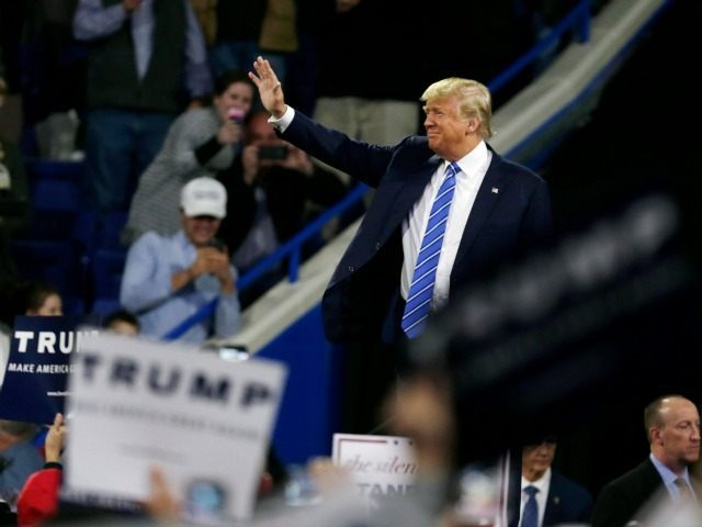 Trump gestures during a gathering at a campaign stop at the Tsongas Center in Lowell, Mass., Monday, Jan. 4, 2016.
